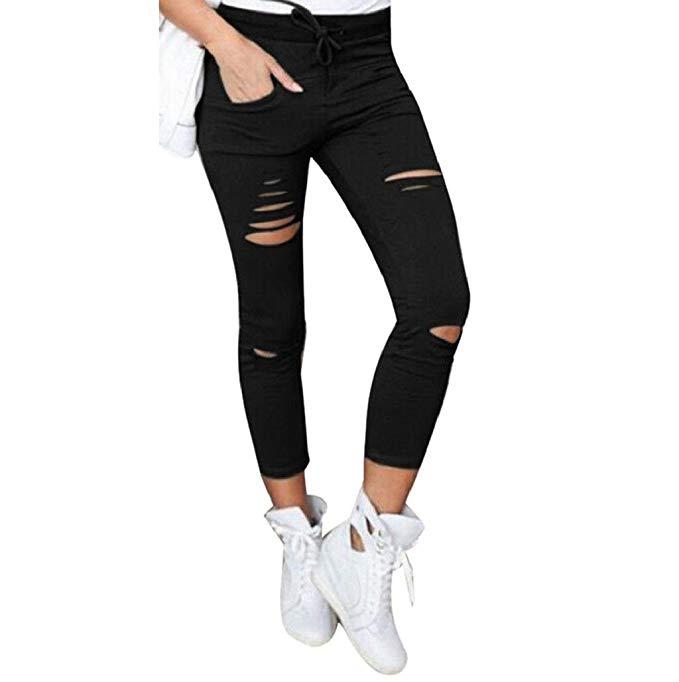 pantalones negros rotos